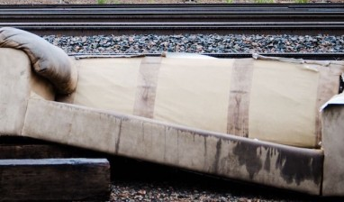 21368102 - an old couch that was previously used by homeless indiduals was dumped next to railroad traks in downtown colorado springs